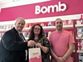 Council leader Richard Farnell with Lauren and Mark Jones in Fizz Bomb