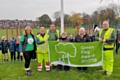 Councillors Susan Emmott and Carol Wardle with Sandra Trickett of Friends of Hopwood Park, Hopwood Community Primary School pupils and Council staff raising the flag at Hopwood Park for the first time