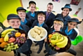 The catering team at Lowerplace Primary School in Rochdale celebrate with Headteacher Garry Johnson. (Left to right: Ellen Golden, Theresa Buckley, Lisa Hill, Marion Roberts, Garry Johnson, Christine Lancelott, Claire Carroll and Saika Ilyas)