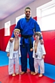 Ricardo Pina with two juniors at a Rochdale Judo Club grading