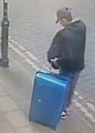 Salman Abedi carrying a distinctive blue suitcase