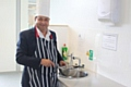 Councillor Ahmed gets ready to cook up a special thank you to council staff