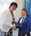 Councillor Janet Emsley with prize winner Sarah Pugh of Parkfield Primary School, Middleton