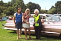 Rochdale Rotary President Ann Stott presenting the Jaguar Car wheel trim trophy to owners of  best car in show