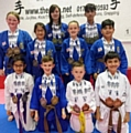 Dojo members with their world medals