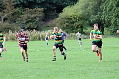 Charlie Sutcliffe on his way to the try line