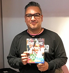 Nikesh Shukla with his book