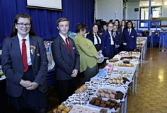 Students at Whitworth Community High School prepare for the Macmillan cake bake sale rush