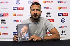 Joe Thompson with his autobiography, 'Darkness and Light: My Story'