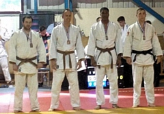 Dave Hulme (right) won three out of three contests to take Gold - Rochdale Judo Club