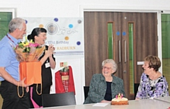 Gladys Radburn being presented with her presents and cake