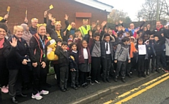 Children from Broadfield School help start Becky Want on her sponsored walk for Children in Need