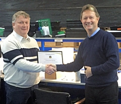 Chris Moore and Mark Tibbenham with his long-service award certificate and gifts
