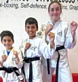 Mohammad Ali,  Aditya Roy and Abigail White from the DOJO Karate Centre with their Black Belts