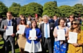 Young people receive their Gold Duke of Edinburgh Award from John Suchet
