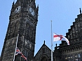 Flags lowered outside the Town Hall in remembrance of the victims who died in the Manchester Arena bombing