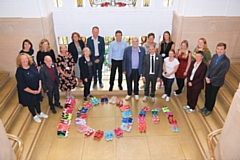 Greater Manchester Health and Care Board and other representatives with �10m spelt out in trainers