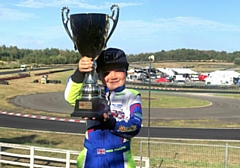 Seven year old Seb Moore with the MBKC Bambino Gold Cup