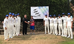 Dexter Fitton of Hanson Springs hands the sponsorship cheque to touring coach Asif Mujtaba who was professional at Norden for 11 years, watched by the Dallas Knights under 17s players