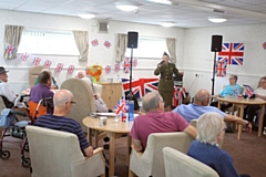 It�s a forties flashback as singer Lynne Sheldon entertains the �troops� at Clough Court.
