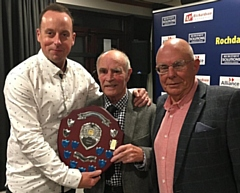 Former Rochdale captain Peter Fletcher (centre) presents the professional�s Player of the Year Shield to Steve Oddy, watched by Alistair Bolingbroke
