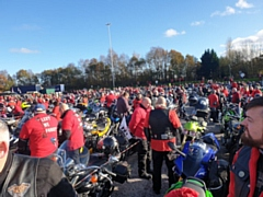 Thousands of bikers wearing red at Birch Services, ready to turn the M60 into a giant poppy