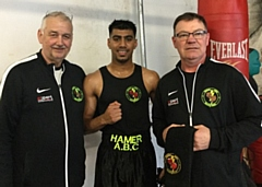 Monir Miah (center) from Hamer Boxing Club with his coaches Alan Bacon and Steven Connellan