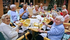 Residents of Derek Walker Court enjoying their free fish and chips
