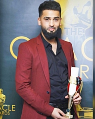Mohammed Ilmaas with his award