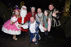 The Mayor and Mayoress (centre) are joined by guests at Rochdale Town Hall for the switch on. (Left to right: Jesamine Oldman, Father Christmas, Mayoress of Rochdale, Mayor of Rochdale, the Mayor's grand-daughter Eleanor Workman, Shane Nolan, and front: Mike Newman).