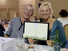 Bee Inspired's Danny Bennett and Pauline Cooper with one of their awards
