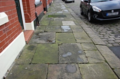 The pavement on Reform Street