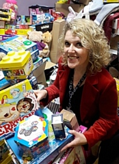 Giving Back Charity Member Helen Walton helping sort the gifts last year