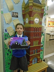 Year Four pupil Imogen O'Brien with her winning design in front of a scaled-down Birch Hill