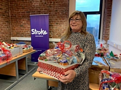 Heywood stroke survivor Frank Clarke and his wife Yvonne (pictured) donated 37 Christmas hampers to help stroke survivors