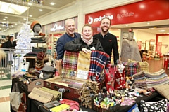 Paul Ambrose, Rochdale BID manager,poses with Jo Jo from Jo Jo's Handmade House and Lorenzo O'Reilly, Rochdale Exchange Shopping Centre Manager, at last year's small business market