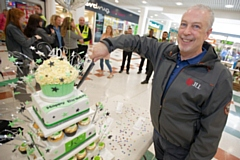 Lorenzo O�Reilly cuts the centre�s birthday cake