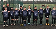 Shawclough U12s with their SG6 boot bags and water bottles from the foundation