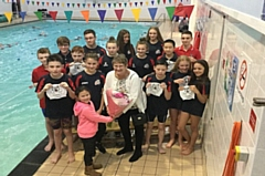 Aquabears receiving their swimming caps from Councillor Jean Hornby