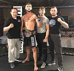 Kyran Sturrock (second left) won bronze at the Mixed Martial Arts European Championships