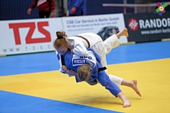 Isobel Kitchen (in blue) completes a Samira Bock Throw