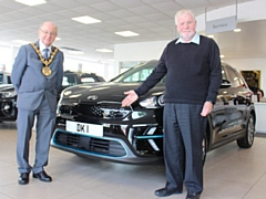 Councillor Billy Sheerin, Mayor of Rochdale, and Councillor Allen Brett, leader of Rochdale Borough Council, with the mayoral electric car, pictured in 2019