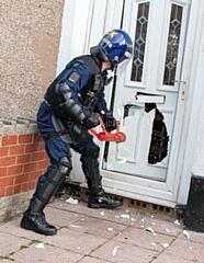 A team of police officers executed warrants in early morning raids (stock image)