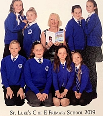 Yvonne Weatherhead, MBE with Isabelle Radcliffe, Remi Sedgley, Phoebe Drennan, Genipher Payne, Evie Chubsey, Grace Lemon-Thompson, Niall Middleton and Aroni Thomas from St Luke�s Primary School, Heywood