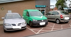 Pharmacy delivery van at Wellfield Health Centre on Oldham Road parked in a disabled parking spot