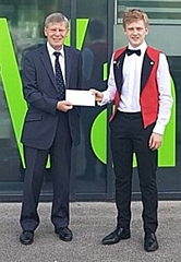 Year 10 student Adam receiving donation from Keith Fairhurst from Rochdale Childer