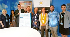 Richard Caulfield, Mental Health lead at the Association of Colleges signs the charter with Julia Heap, Hopwood Hall College staff and Clinical Psychologists from the Nurture-Psychology Service