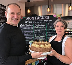 Greg Couzens receives a birthday cake from Debra McGinty, of Montagues Café