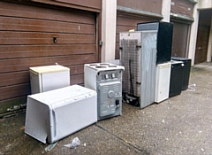 Fridges have been left outside the garages of Tentercroft on College Bank
