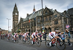 The riders pass along The Esplanade in front of Rochdale Town Hall